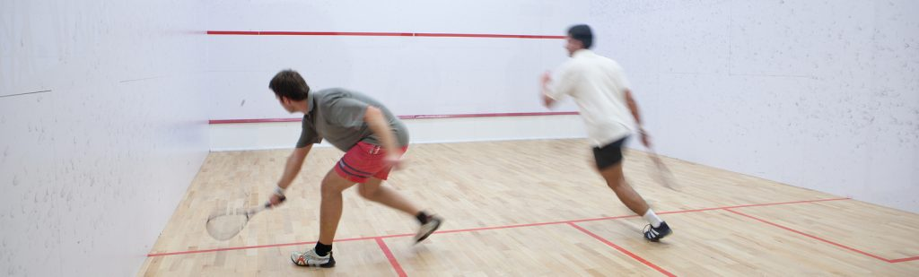 bigstock-Squash-players-in-action-on-a--16440086